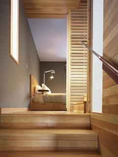 Stairs leading up to guest bedroom.  Architecture: Shim-Sutcliffe.
