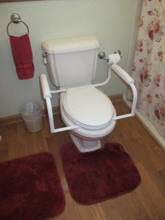 Toilet seat can have bar added