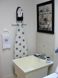 Our laundry room with iron & ironing board.