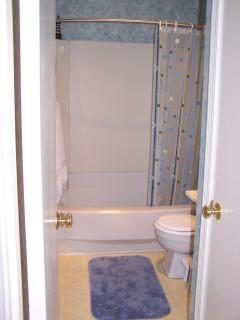 Cozy full bathroom with shower/bath, sink, toilet, and linen/supply closet.