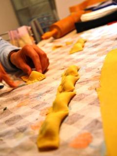 making homemade tortelini with fresh goat cheese