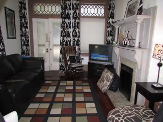 The Living room is beatifully decorated and features a leather queen size sofa sleeper