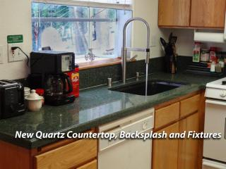 Remodeled Kitchen with new countertops, fixtures, and sink
