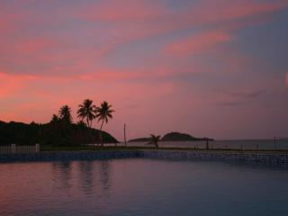 Sunset view across pool to beach, sea, and islands - stunning!