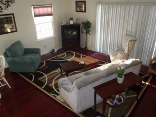 Living room from staircase. All hardwood floors.