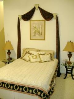 Master bedroom with private bath sleeps 2. Cot available.