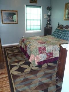 Antique bedroom with oak hardwood floor, sleeps 2