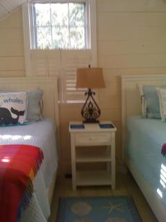 Cozy twin bedroom also has loft with futon
