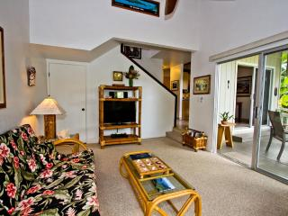 Living Room... tasteful Hawaiian Art and big-flat screen TV. Entrance to Lanai