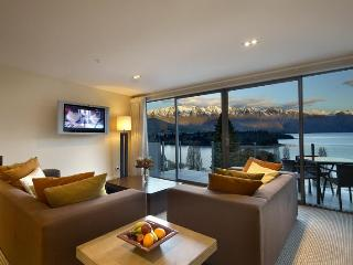 Sitting room and balcony looking over Lake Wakatipu and towards the Remarkables mountain range