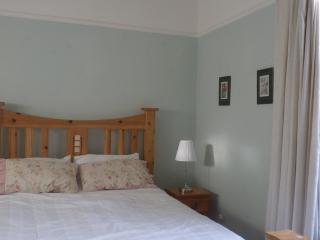 Bedroom with it's huge bespoke bed