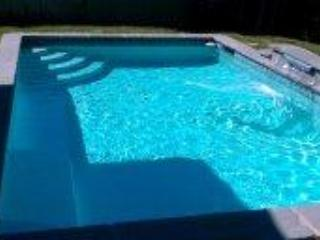 Splash in your own professionally maintained private pool with waterfall