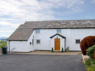BRYN UCHAF, family friendly, character holiday cottage, with a garden in