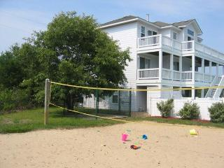 Enjoy beach volleyball--and  backyard sand play for the kids!