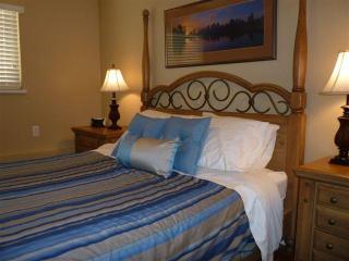 Comfortable  queen bed in master bedroom