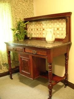 Antique furniture is dotted throughout including in the bathroom!