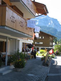 Lane beside chalet. Hohturen first floor. Flags out for Jungfrau Marathon!