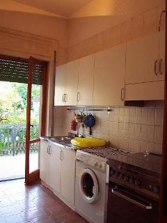 Separated kitchen with balcony