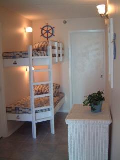 Kids love the hall bunks!  Pocket Door between Bunks and living area...