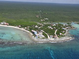 Aerial view: L side Bahia Media Luna, bottom Caribbean & upper R Yal-Ku lagoon