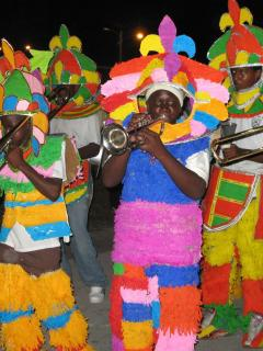 Junior Junkanoo horn players show off their brightly colored hand made costumes in the competition!