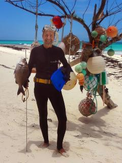 Fishing for dinner at Cayo Loco on your pink sand private Atlantic ocean beach house......mmmm good!