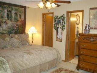 Plush King Mattress with Sumptuous Bedding; 2 doors lead to the Walk-in Closet & Private Bathroom