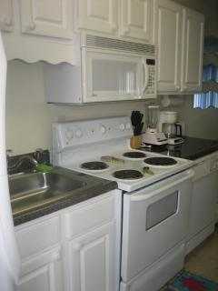 Full Kitchen with full sized refrigerator, stove, dishwasher & microwave