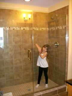 My little girl showing off large shower (it's big enough for two!)