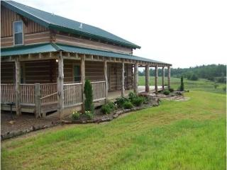 This beautiful log cabin offers beautiful views from the wraparound porch