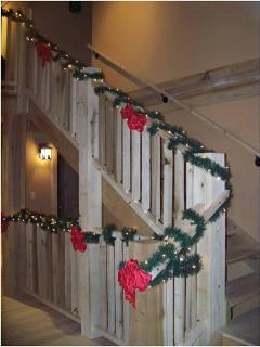 The wood staircase from the main level to the loft