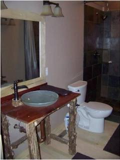 Each bathroom features a custom cedar vanity made from local cedar trees