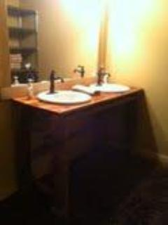 The terrace level offers a bathroom with cedar double vanity, 2 toilet stalls, and 2 shower stalls