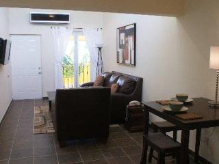 Living Room. Dining Area. Flat Screen Satellite TV, Mini-Split Air Conditioning. Phone WiFi