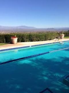 Lap pool looking to view of golf course and mountains
