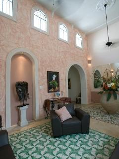 Living room with 18\' ceiling and original tile floors