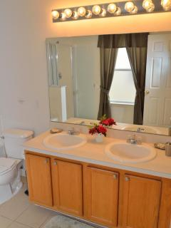 Grand king master ensuite with his and hers sinks