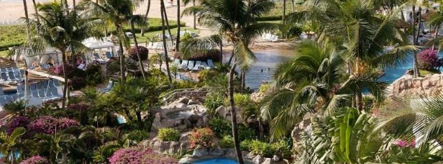 The Grand Wailea's pools include both adult and kids areas in a lush tropical setting in Wailea