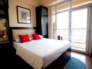Bedroom with full glass sliding doors to balcony