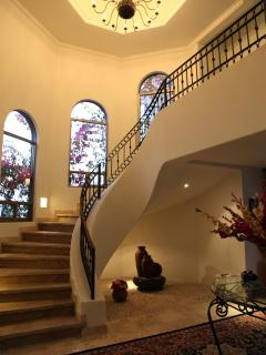 Common area and Spiral staircase leading to all three bedrooms