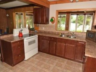 Kitchen with view out to sunroom