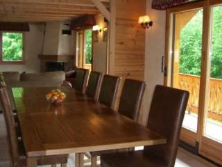 Oak table with leather chairs that seats 12
