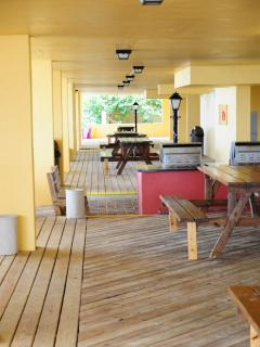Madeira Vista's downstairs deck area with grills and picnic tables.