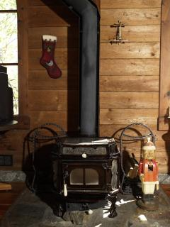 Ceramic wood burning stove provides cozy warmth and atmosphere.  There is also electric heat throughout the Gnome House.