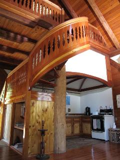 Gorgeous hand carved spiral stairway leading to the master loft with sleigh bed.