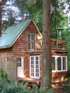 The cottage is nestled in a grove of majestic western red cedars
