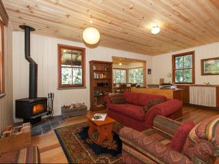 Rose Gum Cottage living room with cosy wood fire