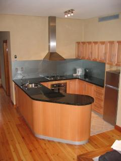 Kitchen - Tassy oak and granite tops