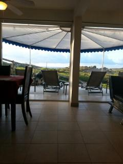 View with patio doors open to ocean and breezes