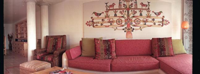 Original art above a fantastic platform sofa